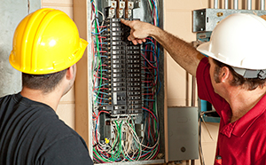 Electrical Panel and two workers